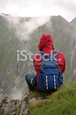 stock-photo-359485-sitting-on-a-ledge-in-the-mountains