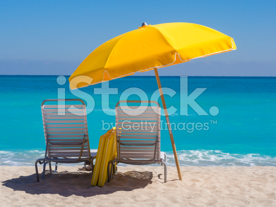stock-photo-23407090-yellow-umbrella-and-deck-chairs-south-beach-miami