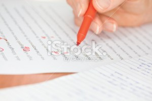 stock-photo-21479480-hand-with-red-pen-transcribing-a-story